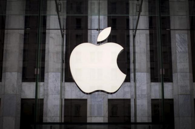 An Apple logo hangs above the entrance to the Apple store on 5th Avenue in the Manhattan borough of New York City