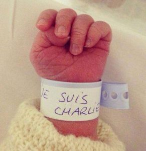 Baby-with-JeSuisCharlie-wrapped-around-arm